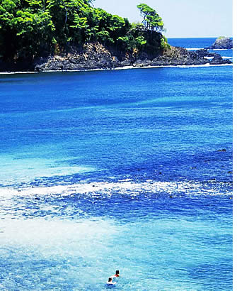 Crystal clear waters surrounding Paridita Island in the Chiriqui Gulf with many majestic shades of blue
